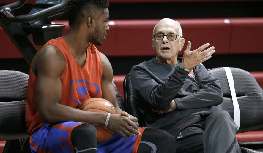 SMU's Semi Ojeleye, left, talks with head basketball coach Larry Brown, right, during a team practice, Monday, Jan. 11, 2016, in Dallas. Hall of Fame coach Brown was back at work Monday, a day after missing the second half of SMU's victory over UCF because he felt dizzy. (AP Photo/Tony Gutierrez)