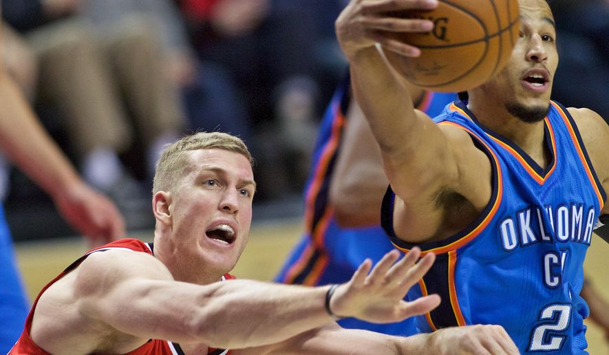 Oklahoma City Thunder guard Andre Roberson, right, collects a loose ball in front of Portland Trail Blazers center Mason Plumlee during the second half of an NBA basketball game in Portland, Ore., Sunday, Jan. 10, 2016. (AP Photo/Craig Mitchelldyer)