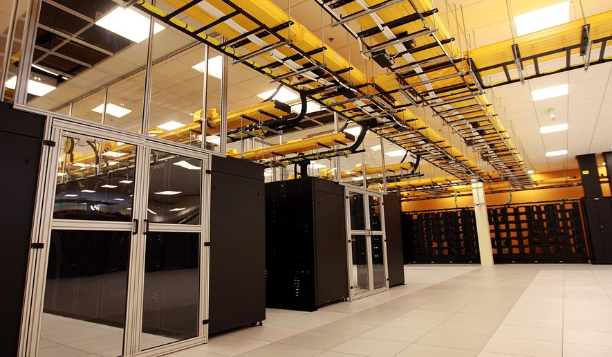 """FILE -  This undated file photo shows the NCAR-Wyoming Supercomputing Center (NWSC) """"Yellowstone"""" supercomputer, among the 60 fastest in the world, used to study weather, climate, oceanography, and other areas of earth science in Cheyenne, Wyo.  """"Yellowstone"""" will be replaced in 2017 by an even faster machine, officials announced Monday, Jan. 11, 2016. The new supercomputer, to be named Cheyenne, will be at least 2 1/2 times more powerful, the National Center for Atmospheric Research said. (Alan Rogers/Casper Star-Tribune via AP)"""
