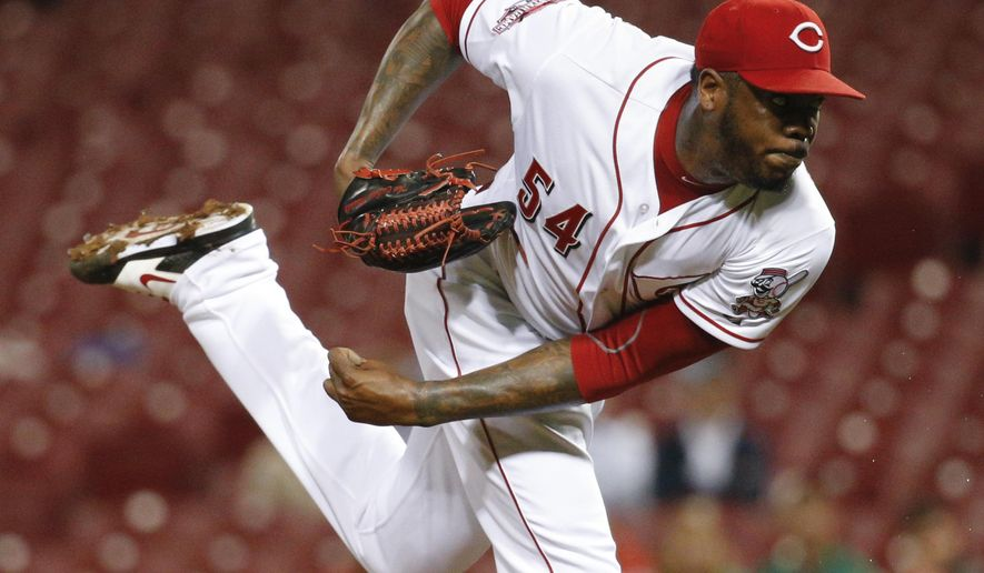 FILE - This Sept. 30, 2015 file photo shows Cincinnati Reds relief pitcher Aroldis Chapman throwing in the ninth inning of a baseball game against the Chicago Cubs in Cincinnati. Yankees manager Joe Girardi said, Monday, Jan. 11, 2016, newly acquired left-hander Aroldis Chapman will go into spring training as New York's closer. (AP Photo/John Minchillo, file)