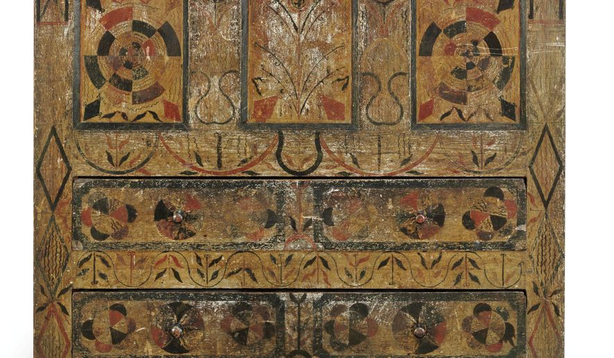 """This undated photo provided by Christie's, shows a 300-year-old Massachusetts chest of drawers embellished with a rare polychrome design - some of it created with a compass tool. The chest is coming to auction on Jan. 22, 2016, at Christie's in New York where it could fetch as much as $500,000. The oak chest is one of only four known examples of a """"Hadley"""" polychrome — or multicolored — pieces believed to be decorated by the same artist. (Christie's Images Ltd. 2015 via AP)"""