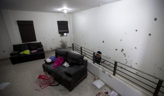 "Bullet holes riddle the walls of the second floor of the home that marines raided in their search for Mexican drug lord Joaquin ""El Chapo"" Guzman in Los Mochis, Mexico, Monday, Jan. 11, 2016. (AP Photo/Eduardo Verdugo)"