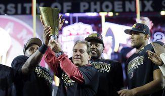 Alabama head coach Nick Saban and players celebrate after the NCAA college football playoff championship game against Clemson Monday, Jan. 11, 2016, in Glendale, Ariz. Alabama won 45-40.  (AP Photo/David J. Phillip)