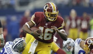 Washington Redskins running back Alfred Morris (46) carries the ball as Dallas Cowboys' Deji Olatoye (29) attempts the stop in the first half of an NFL football game, Sunday, Jan. 3, 2016, in Arlington, Texas. (AP Photo/Tim Sharp)