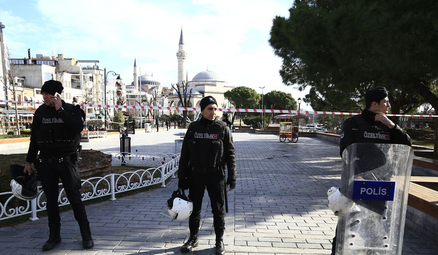 Policemen secure an area at the historic Sultanahmet district, which is popular with tourists, after an explosion in Istanbul, Tuesday, Jan. 12, 2016. The private Dogan news agency says at least two people were hospitalized following an explosion in the historic center of Istanbul. (AP Photo/Lefteris Pitarakis)