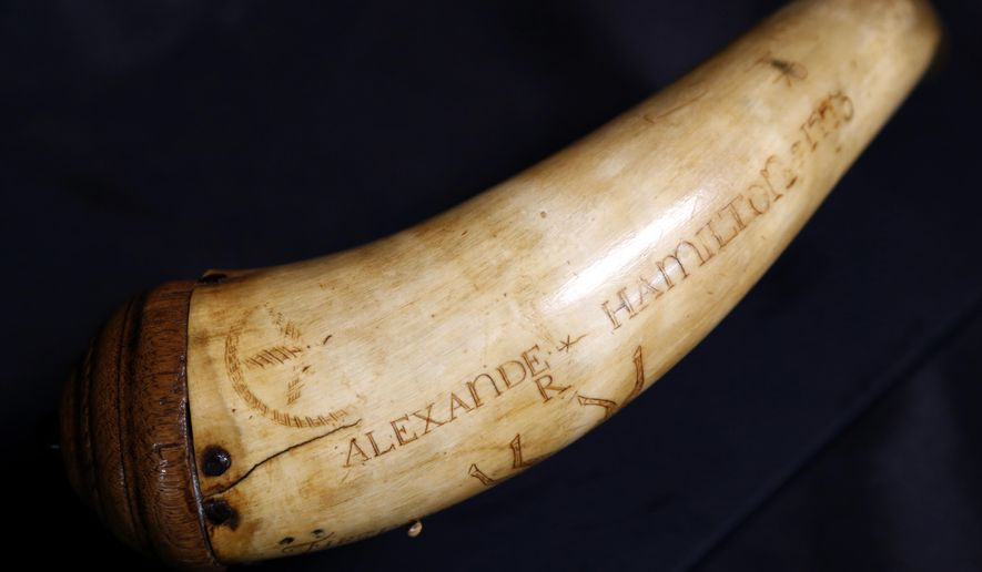 "FILE  In this Tuesday, Dec. 15, 2015, photo, a horn believed to have been owned by Alexander Hamilton is photographed at Antique NJ in Closter, N.J. The powder horn that some experts believe was used by Alexander Hamilton goes up for auction Monday on would have been his birthday. Hamilton, the nation's first treasury secretary and one of the country's Founding Fathers, is now the focus of a blockbuster hip-hop Broadway musical called ""Hamilton."" The owner of the powder horn, a New Jersey dentist, hopes buzz from the show will help boost bids, which start at $10,000 at Sterling Associates in Closter, New Jersey. (AP Photo/Julio Cortez,file)"