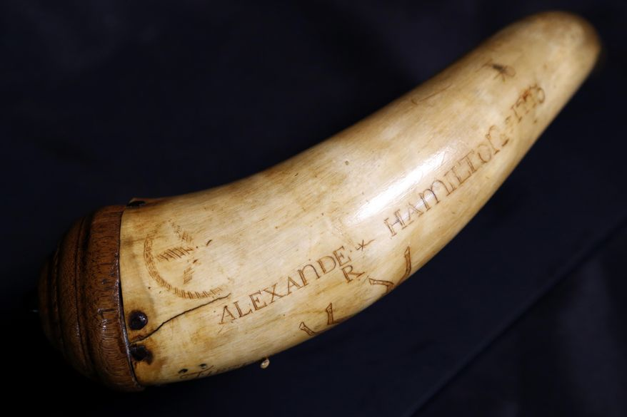 """FILE  In this Tuesday, Dec. 15, 2015, photo, a horn believed to have been owned by Alexander Hamilton is photographed at Antique NJ in Closter, N.J. The powder horn that some experts believe was used by Alexander Hamilton goes up for auction Monday on would have been his birthday. Hamilton, the nation's first treasury secretary and one of the country's Founding Fathers, is now the focus of a blockbuster hip-hop Broadway musical called """"Hamilton."""" The owner of the powder horn, a New Jersey dentist, hopes buzz from the show will help boost bids, which start at $10,000 at Sterling Associates in Closter, New Jersey. (AP Photo/Julio Cortez,file)"""