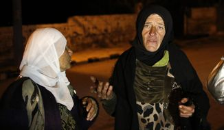 In this Monday, Jan. 11, 2016, photo, residents talk to reporters in the besieged town of Madaya, northwest of Damascus, Syria. Aid convoys reached three besieged villages on Monday — Madaya, near Damascus, where U.N. humanitarian chief Stephen O'Brien said about 400 people need to be evacuated immediately to receive life-saving treatment for medical conditions, malnourishment and starvation, and the Shiite villages of Foua and Kfarya in northern Syria. (AP Photo)