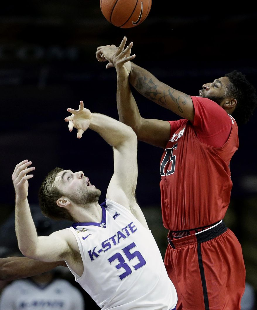 Kansas State's Austin Budke (35) and Texas Tech's Aaron Ross (15) battle for a rebound during the first half of an NCAA college basketball game Tuesday, Jan. 12, 2016, in Manhattan, Kan. (AP Photo/Charlie Riedel)