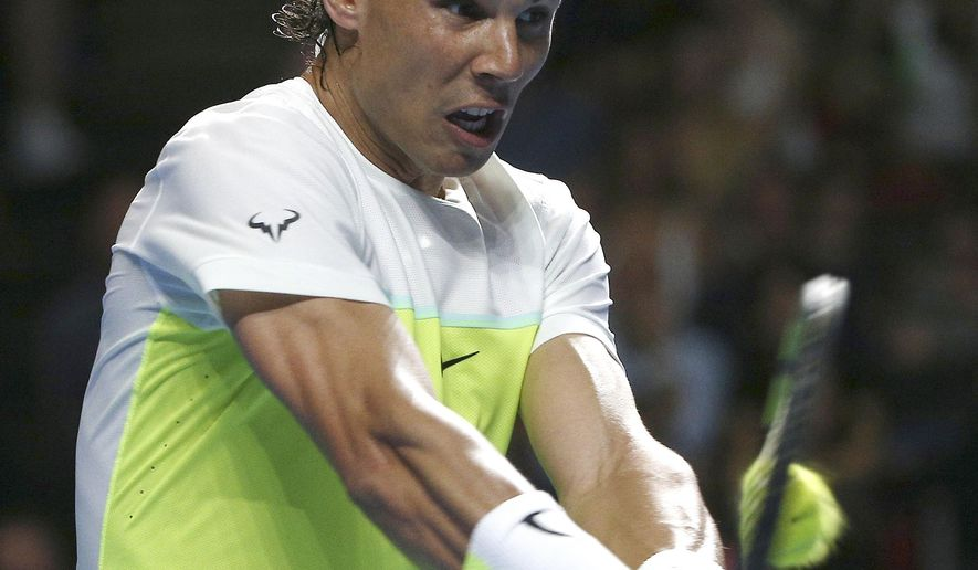 Rafael Nadal of Spain plays a shot during his match against Lleyton Hewitt of Australia in the Fast4 tennis tournament in Sydney, Australia, Monday, Jan. 11, 2016. (AP Photo/Rob Griffith)