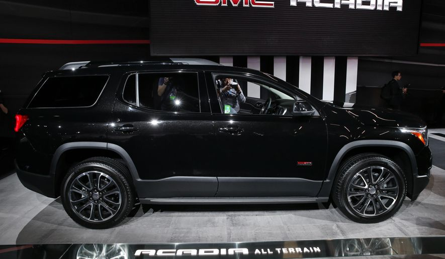 The GMC Acadia debuts at the North American International Auto Show in Detroit, Tuesday, Jan. 12, 2016. (AP Photo/Paul Sancya)