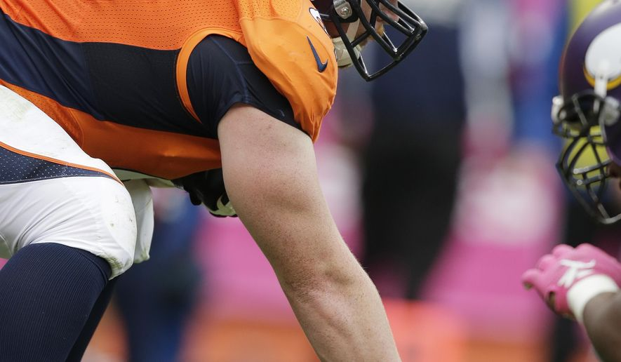 FILE - In this Oct. 4, 2015, file photo, Denver Broncos center Matt Paradis lines up during an NFL football game between the Broncos and the Minnesota Vikings, in Denver. The Broncos' offensive line has resembled both a carousel and a turnstile. The only constant has been first-year starting center Matt Paradis, the only player on the AFC's top-seeded team to play every snap of the season. (AP Photo/Jack Dempsey, File)
