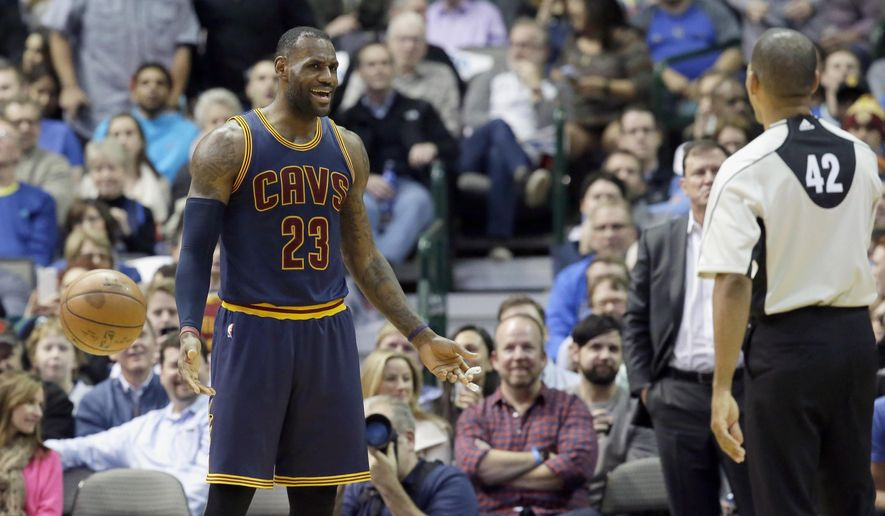 Cleveland Cavaliers forward LeBron James (23) questions a call by referee Eric Lewis (42) during the first half of an NBA basketball game against the Dallas Mavericks, Tuesday, Jan. 12, 2016, in Dallas. (AP Photo/LM Otero)