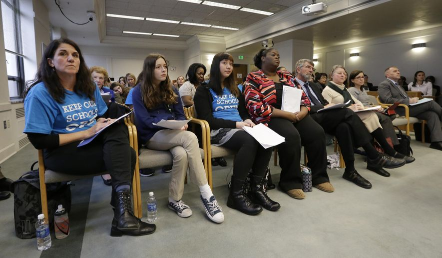 Students, parents, advocates and others fill a hearing room during testimony on two proposed fixes to the state's charter school system, Tuesday, Jan. 12, 2016, in Olympia, Wash. Lawmakers are seeking a way to answer the state Supreme Court's decision last fall that found Washington's new charter school system is unconstitutional. (AP Photo/Elaine Thompson)