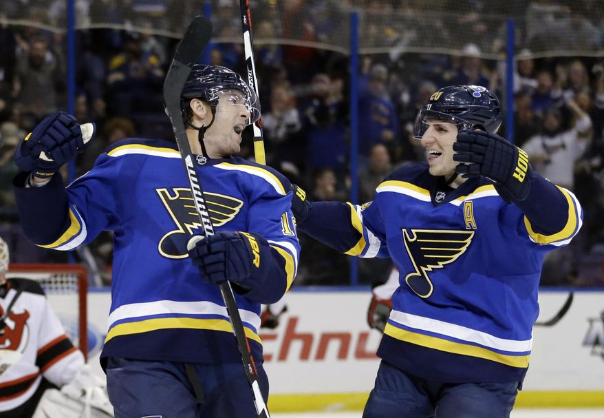 St. Louis Blues' Scottie Upshall, left, is congratulated by Alexander Steen after scoring during the second period of an NHL hockey game against the New Jersey Devils, Tuesday, Jan. 12, 2016, in St. Louis. (AP Photo/Jeff Roberson)