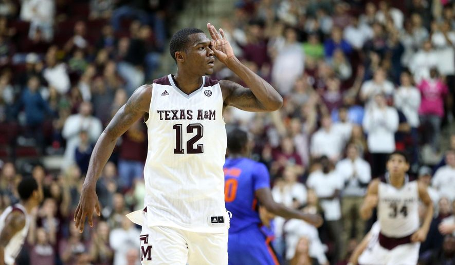 Texas A&M's Jalen Jones (12) makes a three point gesture over his eye after hitting a three point basket at the buzzer of the first half of an NCAA college basketball game against Florida, Tuesday, Jan. 12, 2016, in College Station, Texas.  (AP Photo/Sam Craft)