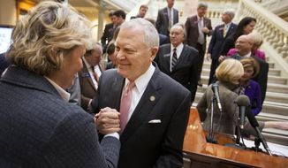 Georgia Gov. Nathan Deal, right, is greeted by lobbyist Yvonne Willams after unveiling details of a plan to improve transportation in the state during a press conference at the Capitol Tuesday, Jan. 12, 2016, in Atlanta. (AP Photo/David Goldman)