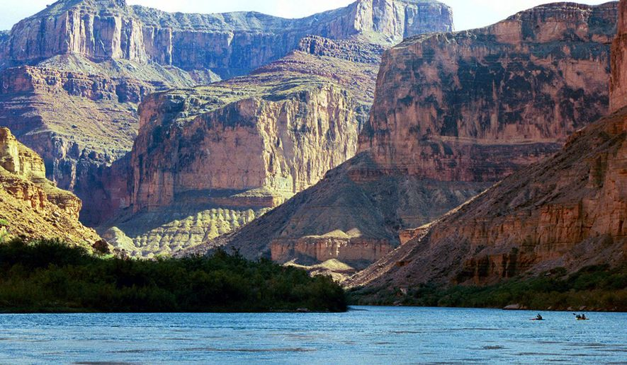 This Aug. 29, 2002, file photo, shows the Colorado River at the Grand Canyon National Park, in Arizona. A new report by a federal watchdog outlines a history of sexual harassment on river rafting trips run by Grand Canyon National Park. The report obtained by The Associated Press comes after 13 current and former park employees filed a complaint in 2014 saying women had been abused. It's set to be released later Tuesday, Jan. 12, 2016, by the Department of the Interior's Office of Inspector General. (AP Photo/Brian Witte, File)
