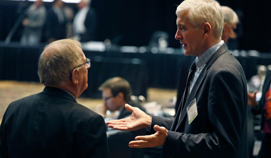 FILE - This is a  Wednesday, Nov. 18, 2015   file photo of Norwegian anti-doping expert Rune Andersen, right, as he speaks with Warwick Gendall of New Zealand before a meeting of the World Anti-Doping Agency (WADA), at the Broadmoor Hotel in Colorado Springs. Rune Andersen the head of the IAAF taskforce set up to determine whether Russia's ban from global track and field should be lifted says the country is making efforts to reform after its doping scandal. (AP Photo/Brennan Linsley, File)