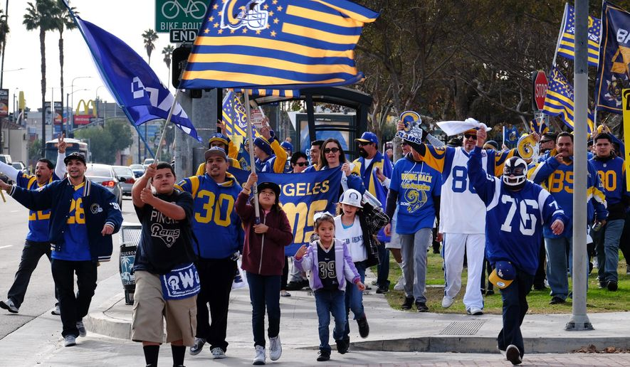 In this Saturday, Jan. 9, 2016 photo Rams fans rally at the Los Angeles Memorial Coliseum. The NFL's owners are expected to decide this week whether any combination of the Rams, Chargers and Raiders will be allowed to move to Los Angeles, finally filling the gaping hole in the sports landscape of the nation's second-largest media market. (AP Photo/Richard Vogel)