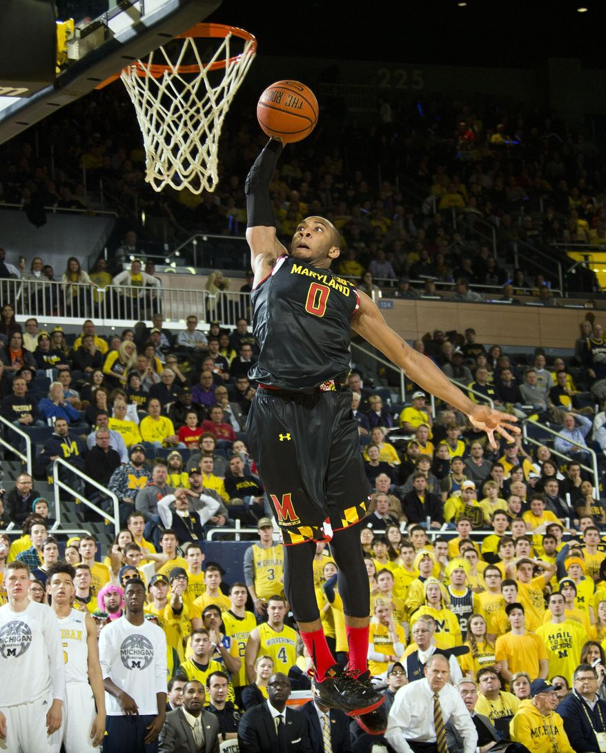 Maryland guard Rasheed Sulaimon (0) goes up for a dunk in the first half of an NCAA college basketball game against Michigan in Ann Arbor, Mich., Tuesday, Jan. 12, 2016. (AP Photo/Tony Ding)
