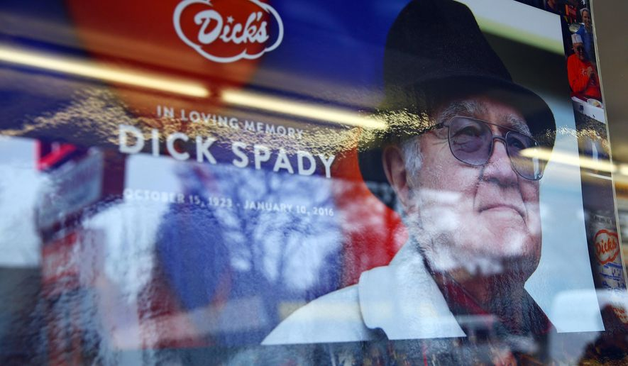 A sign memorizing Dick's Drive-In co-founder Dick Spady hangs in the window of the burger chain's flagship restaurant in Seattle's Wallingford neighborhood, Jan. 12, 2016. Spady, whose string of classic burger joints have become a beloved ritual for many in the Seattle area, has died. He was 92. Spady died of natural causes in Seattle on Sunday, said Jasmine Donovan, his granddaughter and company spokeswoman.  (Genna Martin/seattlepi.com via AP) MAGS OUT; NO SALES; SEATTLE TIMES OUT; TV OUT; MANDATORY CREDIT