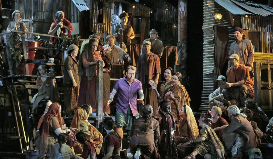 """This Dec. 28, 2015 photo released by the Metropolitan Opera shows a performance of Georges Bizet's opera """"Les Pecheurs de Perles"""" (The Pearl Fishers). The Met's HD broadcast will be shown in participating theaters starting at 1pm EST on Saturday. (Ken Howard/Metropolitan Opera via AP)"""