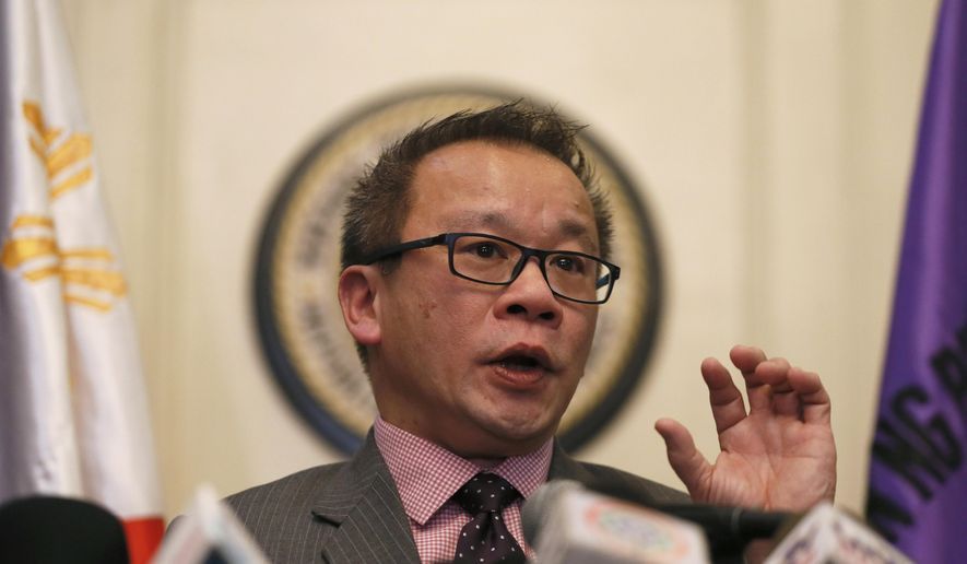 """Philippine Supreme Court spokesman Theodore Te briefs the media on the highest court's decision declaring the constitutionality of the Enhanced Defense Cooperation Agreement or EDCA, in Manila, Philippines, Tuesday, Jan. 12, 2016. The court declared as constitutional on Tuesday the 10-year defense pact that allows American forces, warships and planes to temporarily base in local military camps in a boost to U.S. efforts to reassert its presence in Asia, where China has loomed large. """"EDCA is not constitutionally infirm as an executive agreement,"""" Te said. (AP Photo/Bullit Marquez)"""