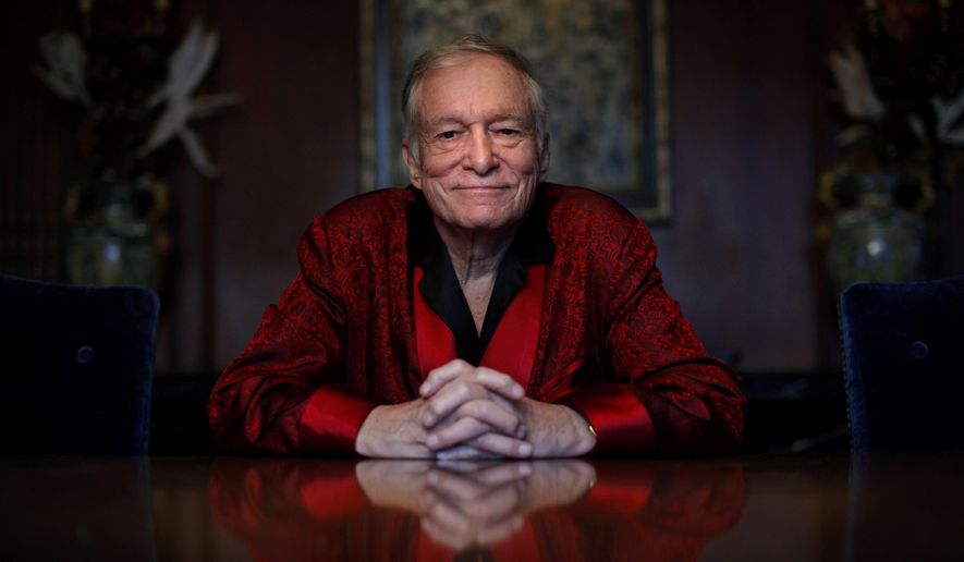 In this Nov. 4, 2010, file photo, Playboy magazine founder Hugh Hefner poses for photos at the Playboy Mansion in Los Angeles. (AP Photo/Jae C. Hong, File)