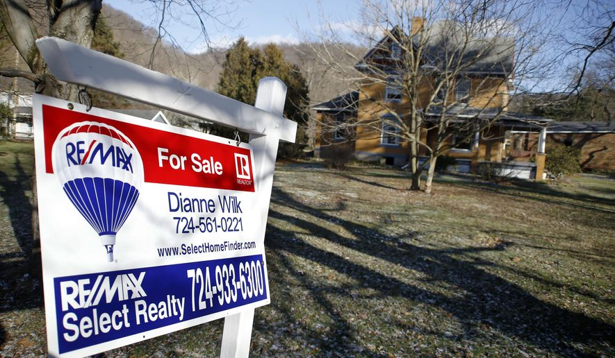 """A realtor sign in front of the house used as the home of psychotic killer Buffalo Bill in the 1991 film """"The Silence of the Lambs"""" is seen on Monday, Jan. 11, 2016 in Perryopolis, Pa. Scott and Barbara Lloyd listed the house last summer, but they've dropped the asking price from $300,000 to $250,000. The three-story Victorian was the second-most clicked home on Realtor.com last year, but no serious buyers. (AP Photo/Keith Srakocic)"""