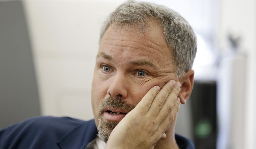 In this Nov. 18, 2015 photo, Doug Hunt, supervisory special agent in charge with the human trafficking division of the FBI, speaks during an interview at his office in San Francisco. For the first time in its efforts to crack down on sex trafficking during the Super Bowl, the FBI will try to reach out to women and girls selling sex in the run-up to the game to give them a way out and get them to turn against their traffickers. (AP Photo/Eric Risberg)