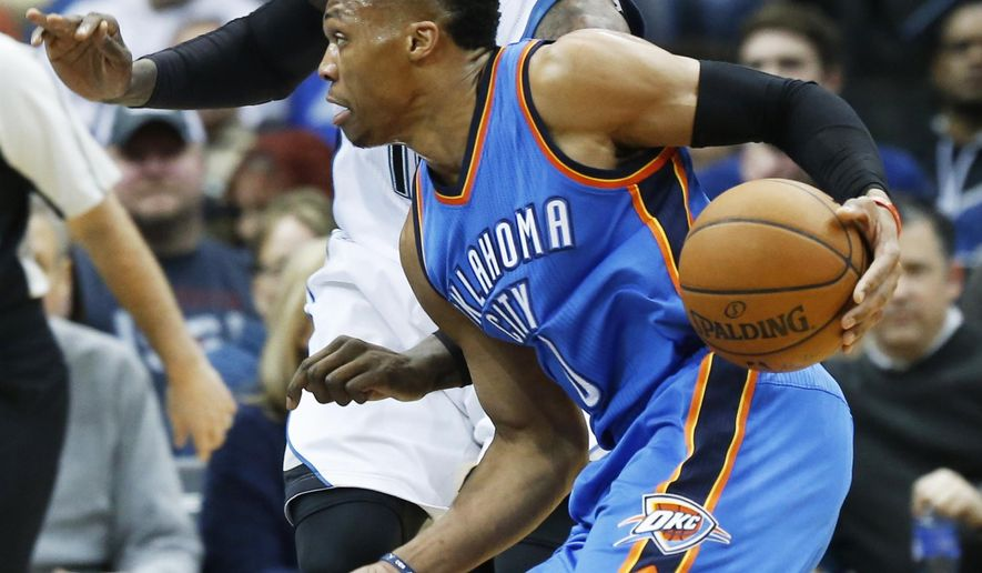 Oklahoma City Thunder's Russell Westbrook, right, drives around Minnesota Timberwolves' Shabazz Muhammad in the first quarter of an NBA basketball game Tuesday, Jan. 12, 2016, in Minneapolis. (AP Photo/Jim Mone)