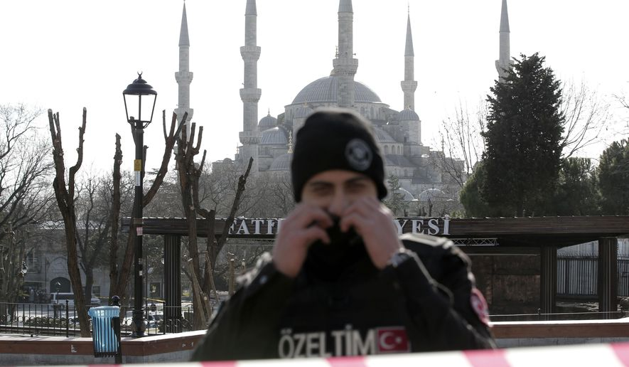 A policeman guards in front of the Blue Mosque at the historic Sultanahmet district after an explosion in Istanbul, Tuesday, Jan. 12, 2016. An explosion in a historic district of Istanbul popular with tourists killed 10 people and injured 15 others Tuesday morning, the Istanbul governor's office said. (AP Photo/Lefteris Pitarakis)