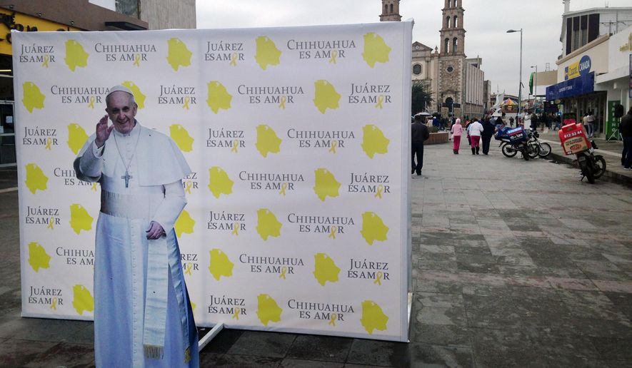 This photo taken Jan. 5, 2016, shows an installation of Pope Francis advertising the pope's upcoming visit to Juarez, Mexico. The city, on Mexico's northern border across from El Paso, Texas, is the last stop in the Pope's schedule 5-day trip to Mexico and officials on both sides of the border are preparing for the visit between Feb. 12-17. (AP Photo/Russell Contreras)