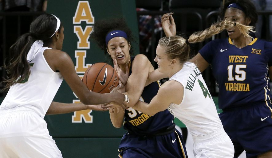 Baylor's Khadijiah Cave, left, and Kristy Wallce (4) attempt to strip the ball from West Virginia's Arielle Roberson, center, as Lanay Montgomery (15) watches during the first half of an NCAA college basketball game, Tuesday, Jan. 12, 2016, in Waco, Texas. (AP Photo/Tony Gutierrez)