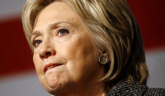 Democratic presidential candidate Hillary Clinton pauses while speaking during a campaign event at Iowa State University in Ames, Iowa, Tuesday, Jan. 12, 2016. (AP Photo/Patrick Semansky)
