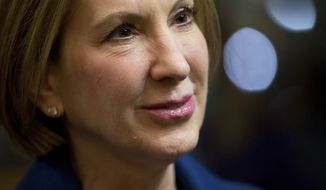 Republican presidential candidate Carly Fiorina speaks with a guest at a welcome back reception for members of the Iowa legislature at the State Historical Building of Iowa in Des Moines, Iowa, Tuesday, Jan. 12, 2016. (AP Photo/Andrew Harnik)