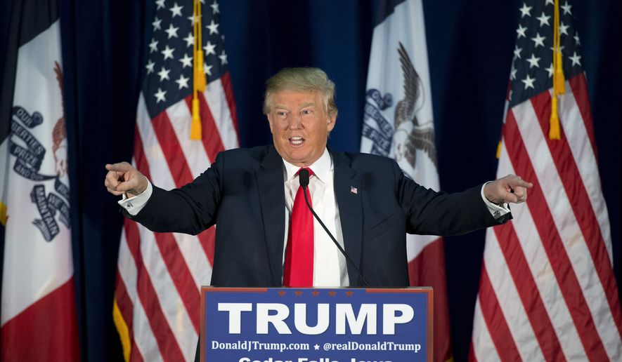 Republican presidential candidate Donald Trump points to the crowd while speaking at a rally Tuesday, Jan. 12, 2016, in Cedar Falls, Iowa. (AP Photo/Jae C. Hong)