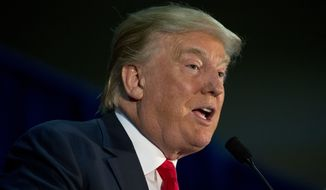 Republican presidential candidate Donald Trump addresses supporters at a rally, Tuesday, Jan. 12, 2016, in Cedar Falls, Iowa. (AP Photo/Jae C. Hong)