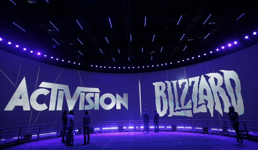 """FILE - This June 13, 2013 file photo shows the Activision Blizzard Booth during the Electronic Entertainment Expo in Los Angeles. Activision Blizzard Inc. is enlisting the producer of """"The Hateful Eight"""" to help lead its TV and film studio. The video game publisher said Wednesday, Jan. 13, 2016, that Stacey Sher will serve as co-president of Activision Blizzard Studios with Nick van Dyk, who assumed the role last year. (AP Photo/Jae C. Hong, File)"""