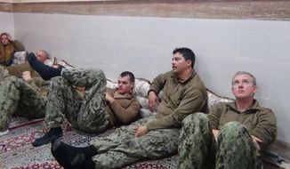 This picture released by the Iranian Revolutionary Guards on Wednesday, Jan. 13, 2016, shows detained American Navy sailors in an undisclosed location in Iran. Iranian state television is reporting that all 10 U.S. sailors detained by Iran after entering its territorial waters have been released. Iran's Revolutionary Guard said the sailors were released Wednesday after it was determined that their entry was not intentional. (Sepahnews via AP)