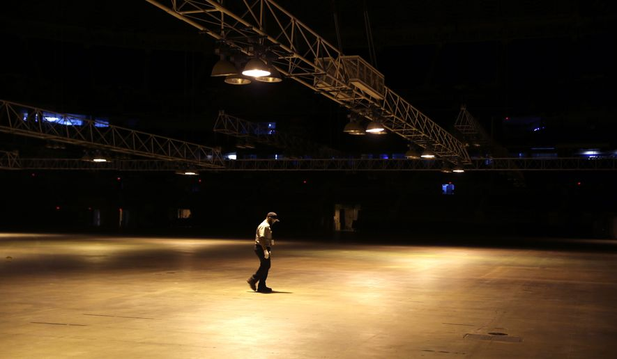 A worker walks across the empty floor of the Edward Jones Dome, former home of the St. Louis Rams, Wednesday, Jan. 13, 2016, in St. Louis. NFL owners voted on Tuesday to move the Rams from St. Louis to Los Angeles starting with the 2016 season. (AP Photo/Jeff Roberson)