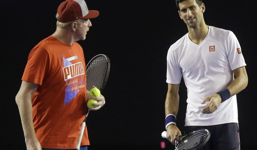 Defending champion, Serbia's Novak Djokovic, right, talks with his coach Boris Becker during a practice session on Rod Laver Arena ahead of the Australian Open tennis championships in Melbourne, Australia, Wednesday, Jan. 13, 2016. The Australian Open begins here on Monday Jan 18. (AP Photo/Mark Baker)
