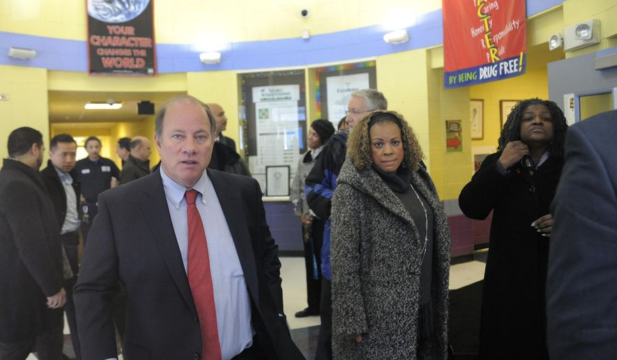 Detroit Mayor Mike Duggan, left, leaves Fisher Magnet Lower Academy in Detroit, Tuesday, Jan. 12, 2016, after talking with school administrators and Detroit Public Schools officials about the condition of the school. The visits occurred while two dozen schools were closed because of a sick-out by teachers who are upset about pay, class sizes, rodents and mold. (Jose Juarez/Detroit News via AP)  DETROIT FREE PRESS OUT; HUFFINGTON POST OUT; MANDATORY CREDIT
