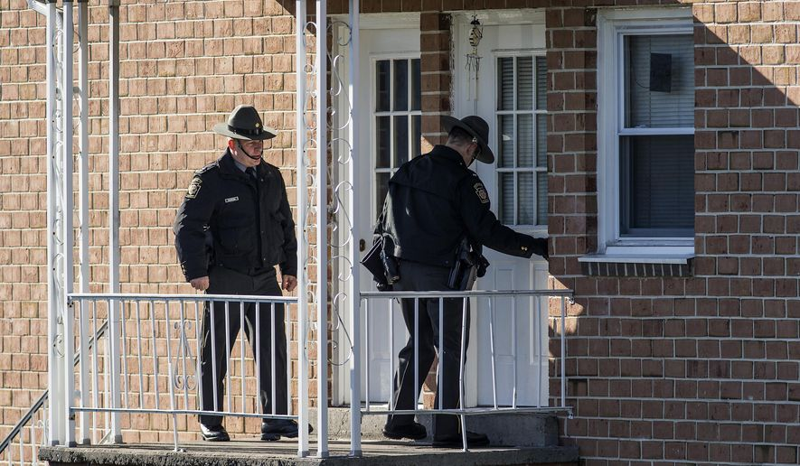 In this Monday, Jan. 11, 2016 photo, State police investigate the scene of a deadly shooting at Pfautz Rentals apartments in Penn Township, Pa. Authorities said a 12-year-old girl was shot and killed during a confrontation between her father and a state constable serving an eviction order at their central Pennsylvania apartment. (Dan Gleiter/PennLive.com via AP) MANDATORY CREDIT