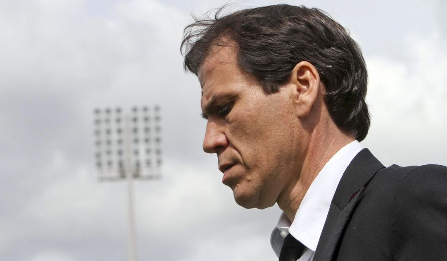 FILE - In this April 6, 2014 file photo, Roma coach Rudy Garcia walks off the pitch after a Serie A soccer match between Cagliari and Roma in Cagliari, Italy. In a statement released Wednesday, Jan. 13, 2016, Roma soccer club announced that it has fired coach Rudi Garcia after only one win in its last 10 matches in all competitions. (AP Photo/Daniela Santoni)