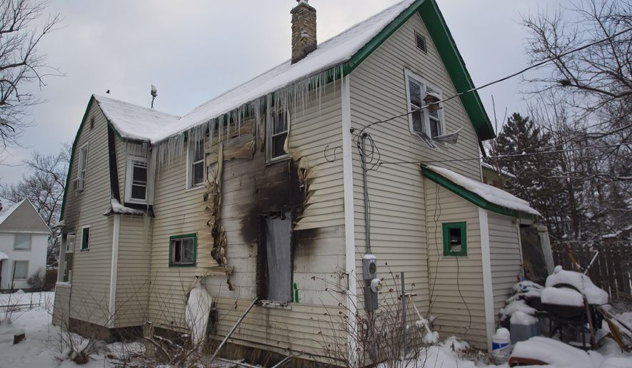 Fire damage is seen at a Sigsbee St house in Grand Rapids, Mich., Wednesday, Jan. 13, 2016. Two people were injured in the early morning fire where authorities reportedly found a marijuana growing operation. (Cory Morse/The Grand Rapids Press via AP) ALL LOCAL TELEVISION OUT; LOCAL TELEVISION INTERNET OUT; MANDATORY CREDIT
