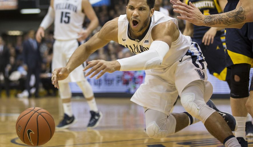 Villanova guard Josh Hart (3) chases a loose ball during the first half of an NCAA college basketball game against Marquette, Wednesday, Jan. 13, 2016, in Villanova, Pa. (AP Photo/Laurence Kesterson)