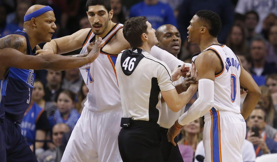 Officials Ben Taylor (46) and Courtney Kirkland, second from right, separate Dallas Mavericks forward Charlie Villanueva, left, and Oklahoma City Thunder guard Russell Westbrook (0), with help from Thunder center Enes Kanter, second from left, during an altercation in the second quarter of an NBA basketball game in Oklahoma City, Wednesday, Jan. 13, 2016. (AP Photo/Sue Ogrocki)