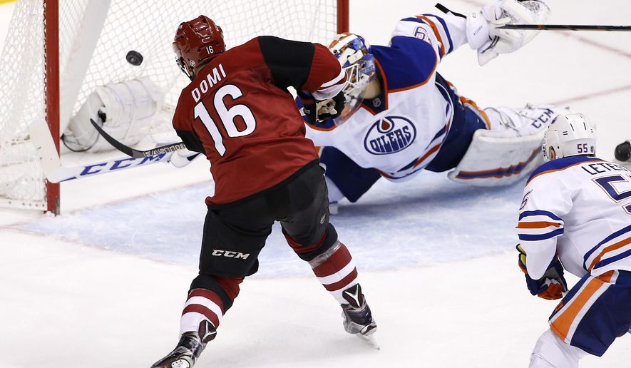 Arizona Coyotes' Max Domi (16) scores a goal on Edmonton Oilers' Anders Nilsson, top right, of Sweden, as Oilers' Mark Letestu (55) watches during the second period of an NHL hockey game Tuesday, Jan. 12, 2016, in Glendale, Ariz. (AP Photo/Ross D. Franklin)